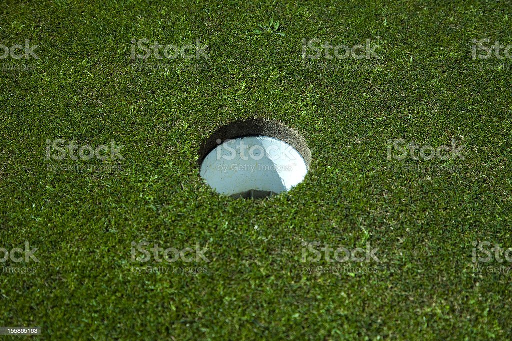 Golf hole on the green royalty-free stock photo