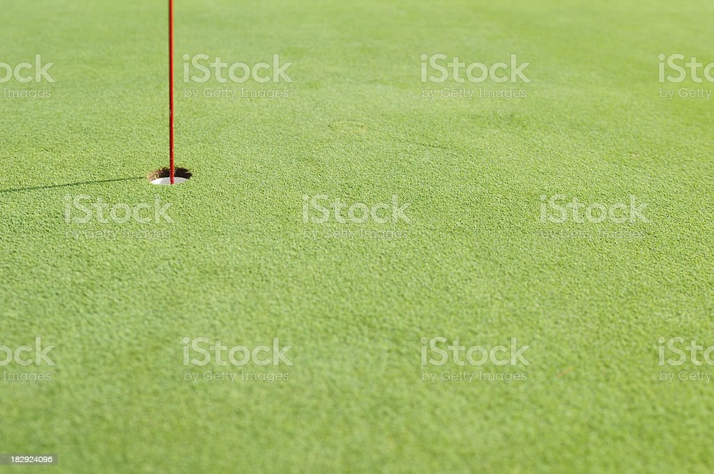 Golf hole with flag pole royalty-free stock photo