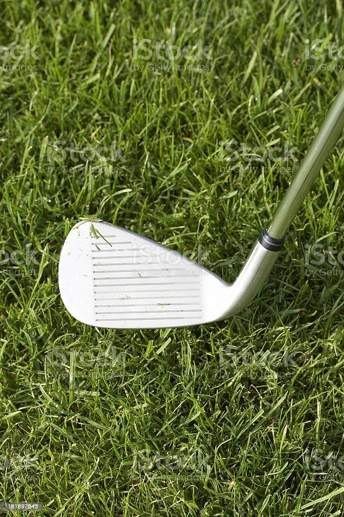 Golf iron on grass stock photo
