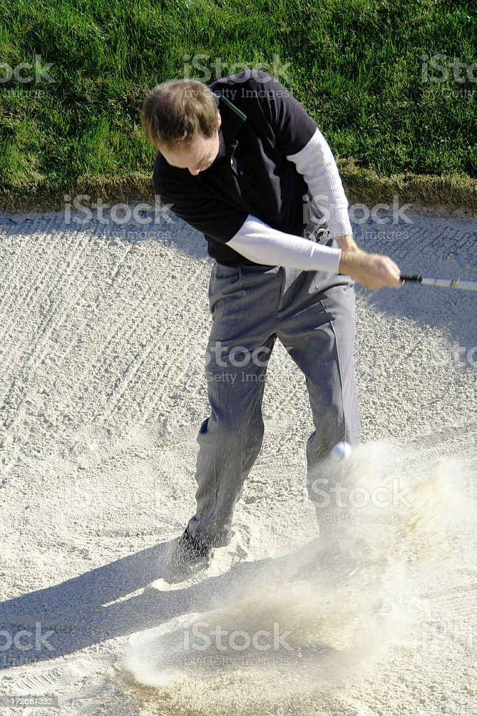 Golf Man Hitting In Sand Trap royalty-free stock photo
