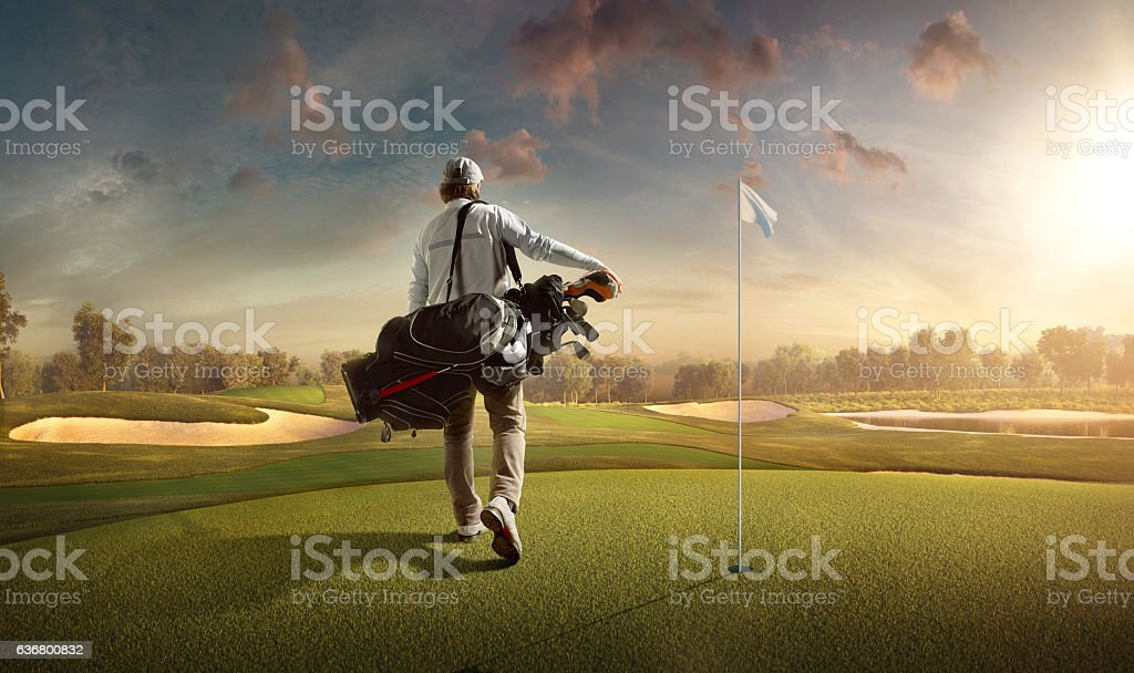 Golf: Man playing golf in a golf course stock photo