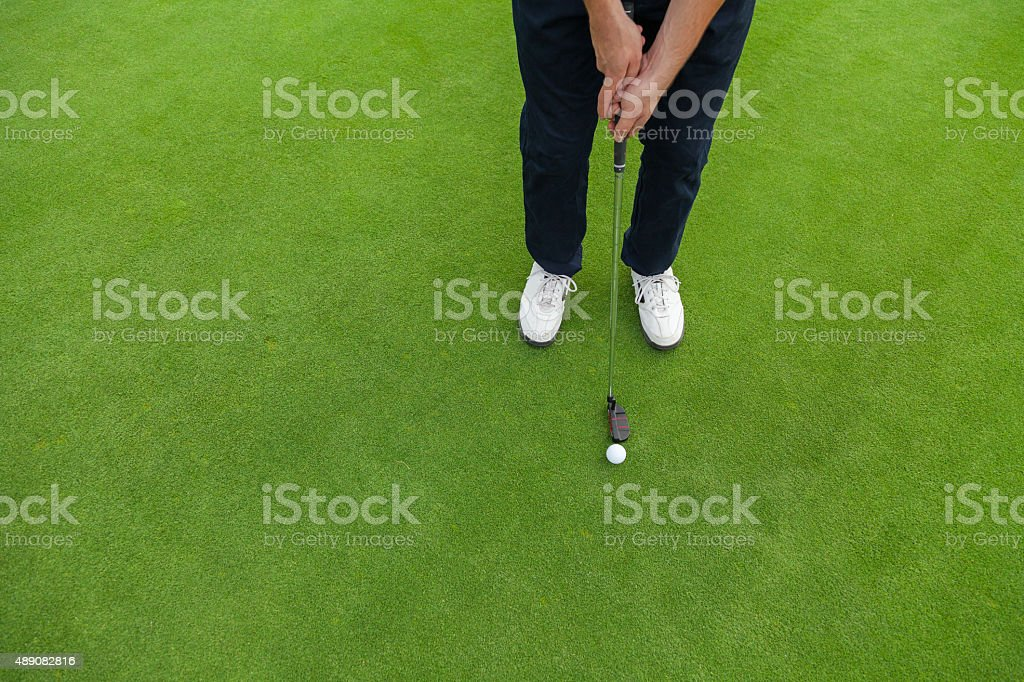 Golf player at the putting green stock photo