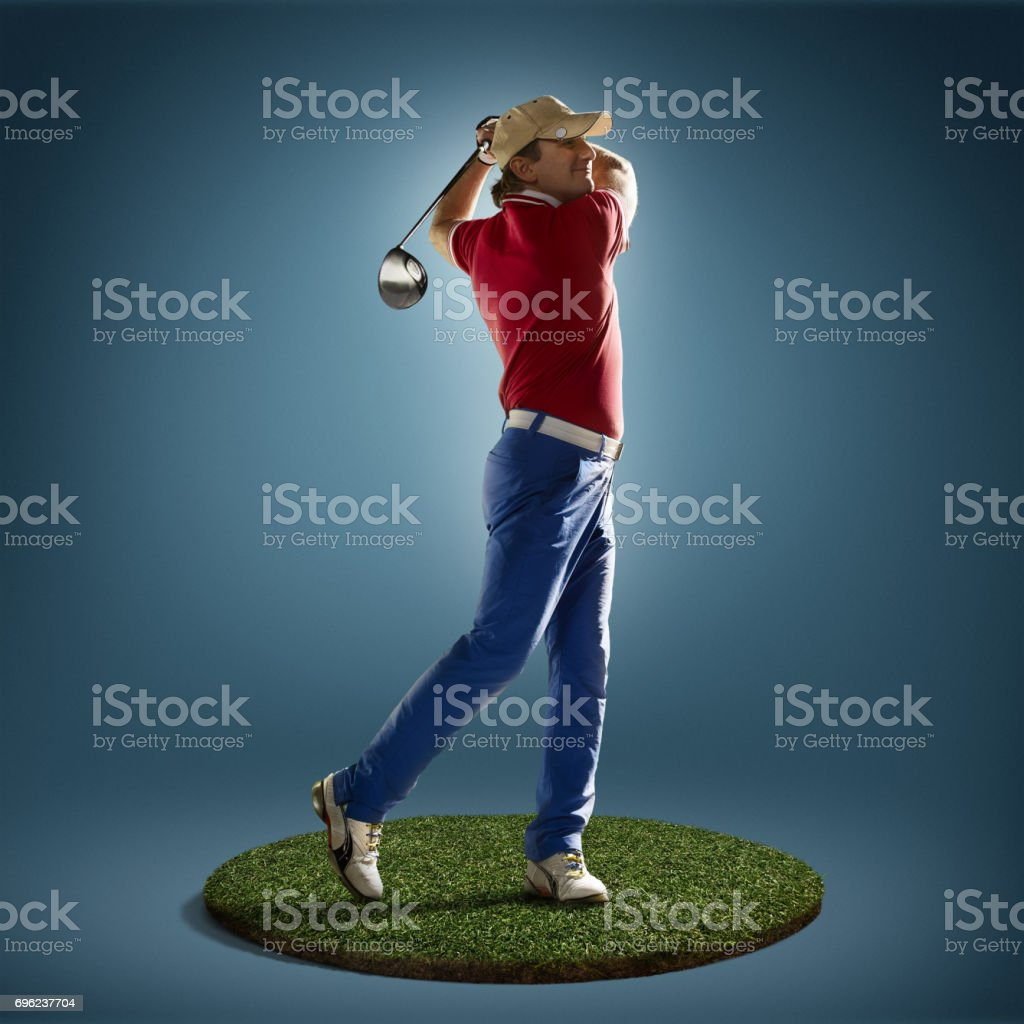 Golf player in action stock photo