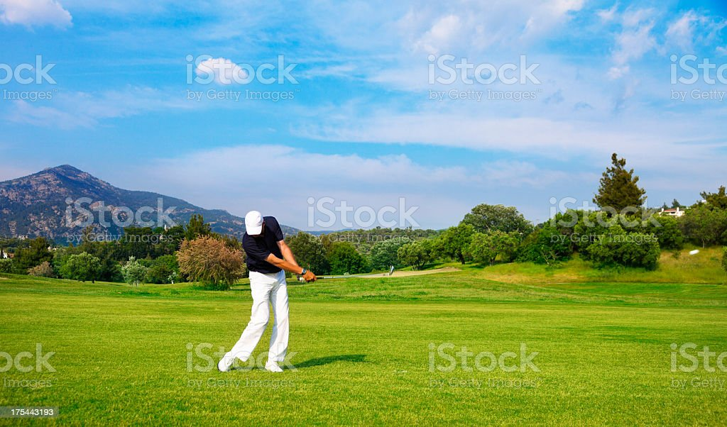 A golf player playing a game on a large course stock photo