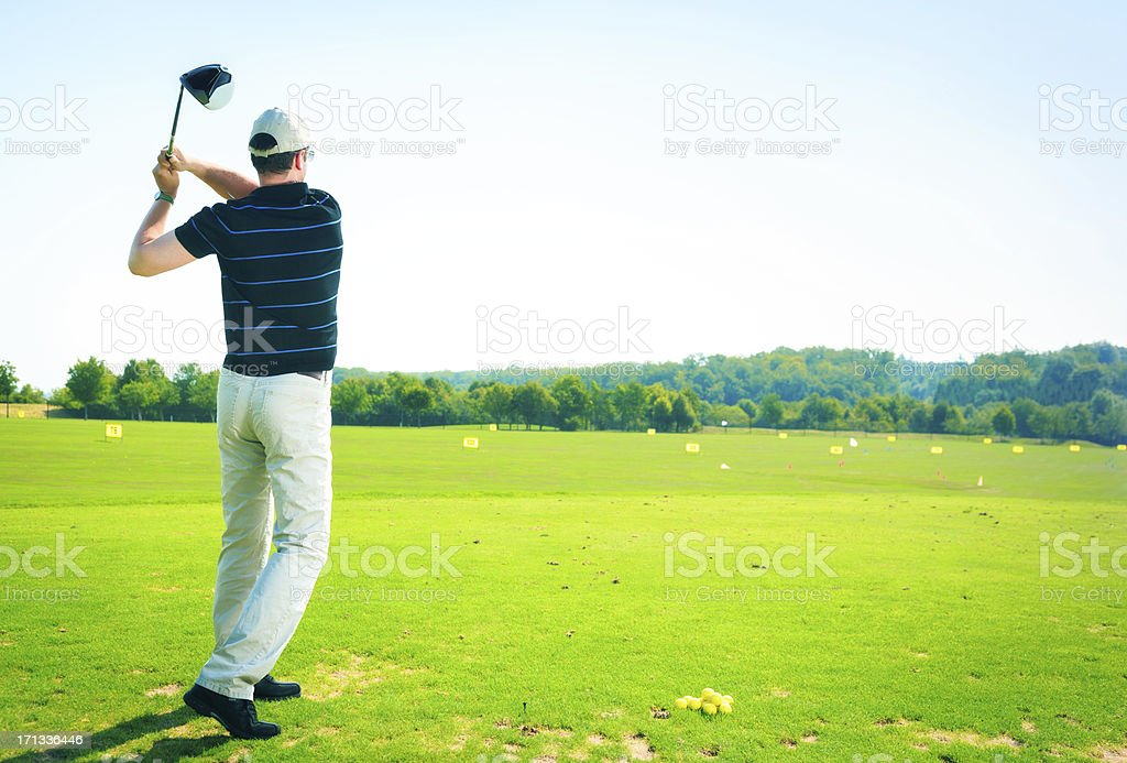golf player practicing royalty-free stock photo