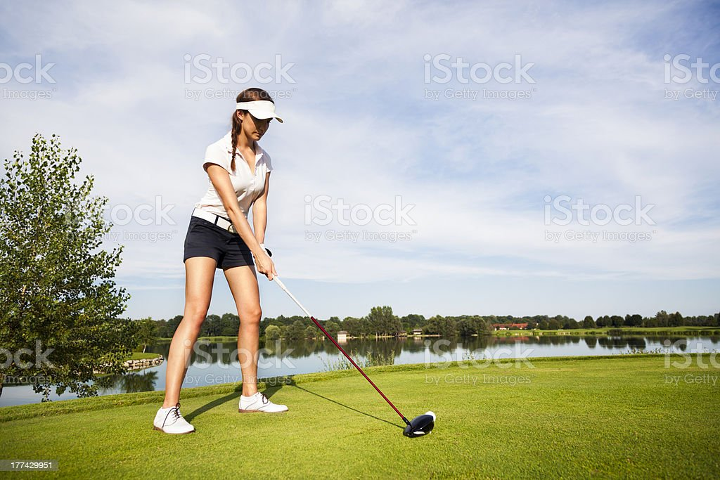 Golf player preparing for teeing off. stock photo