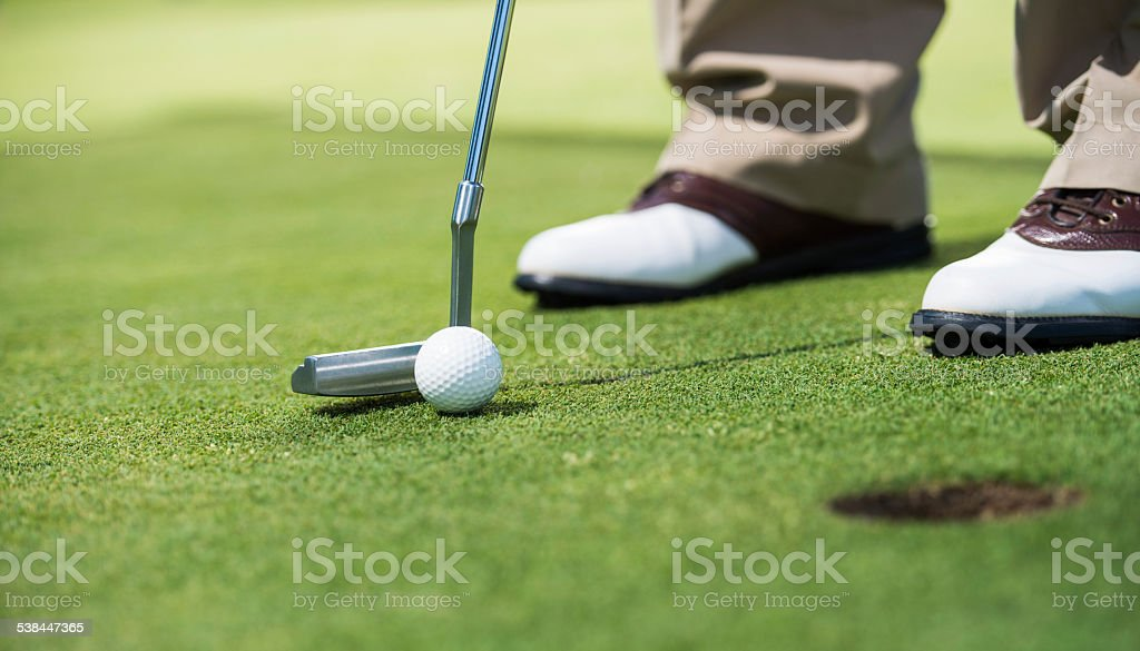 Golf player putting green. stock photo