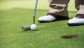 Golf player putting green.