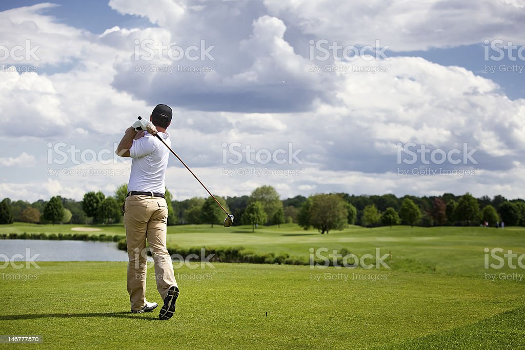 Golf player teeing off royalty-free stock photo