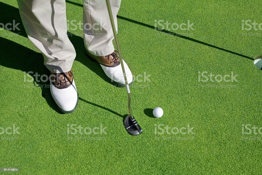 Golf player trying to make the putt stock photo