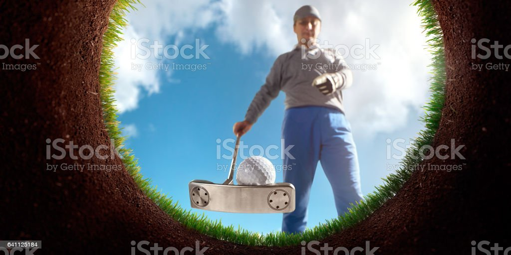 Golf: Point of view from inside the hole stock photo
