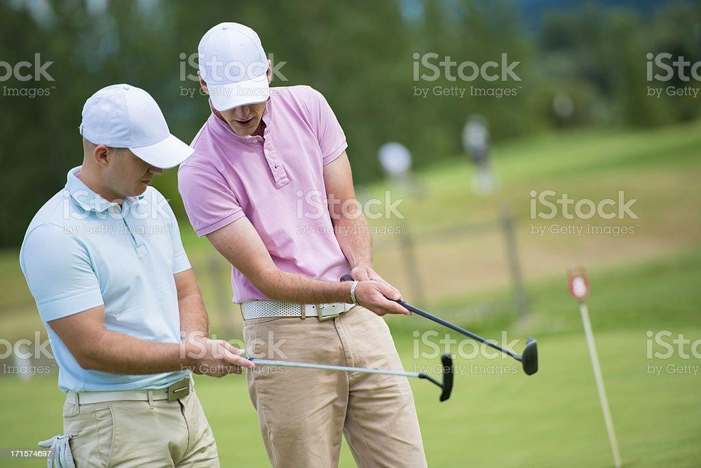 Golf Pro Teaching Male Golfer royalty-free stock photo