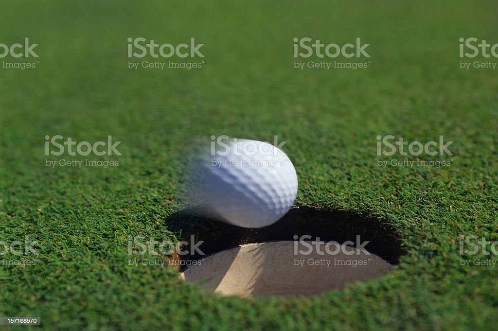 golf putt dropping in stock photo