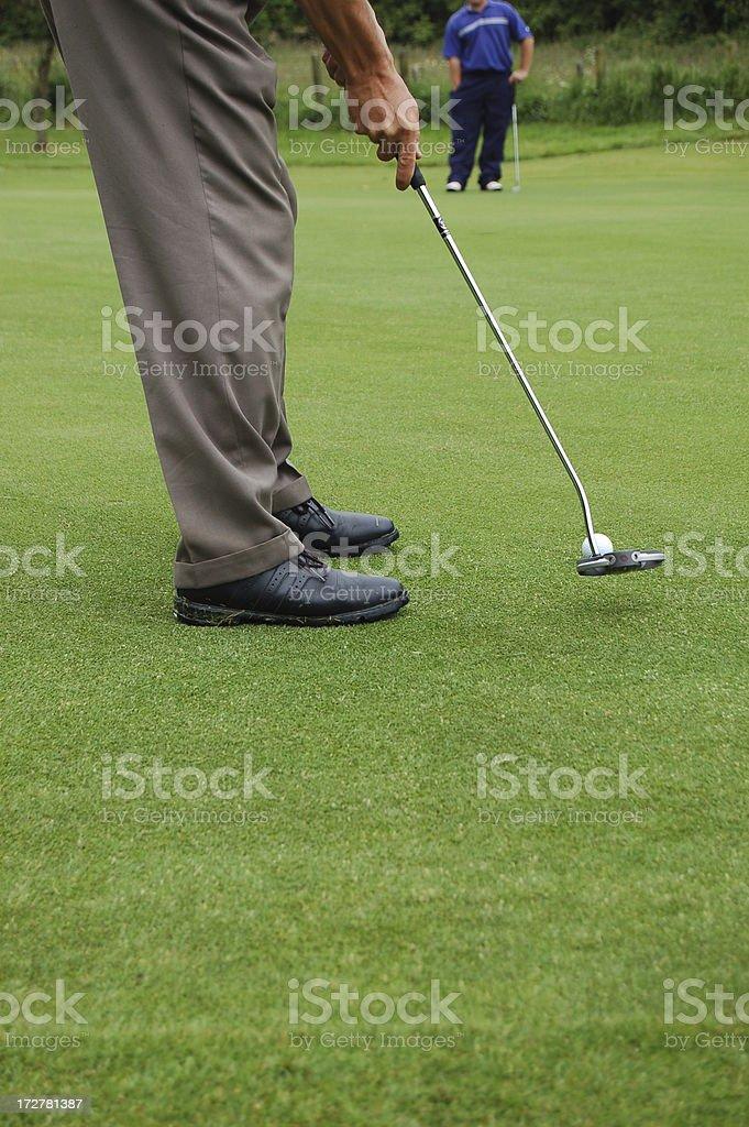 Golf Putt. stock photo