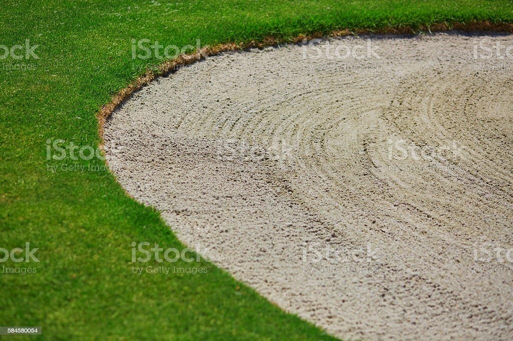 golf sand bunker stock photo