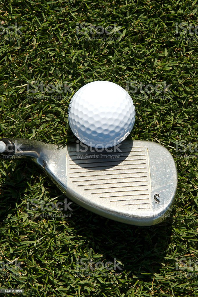 Golf sand wedge at address stock photo