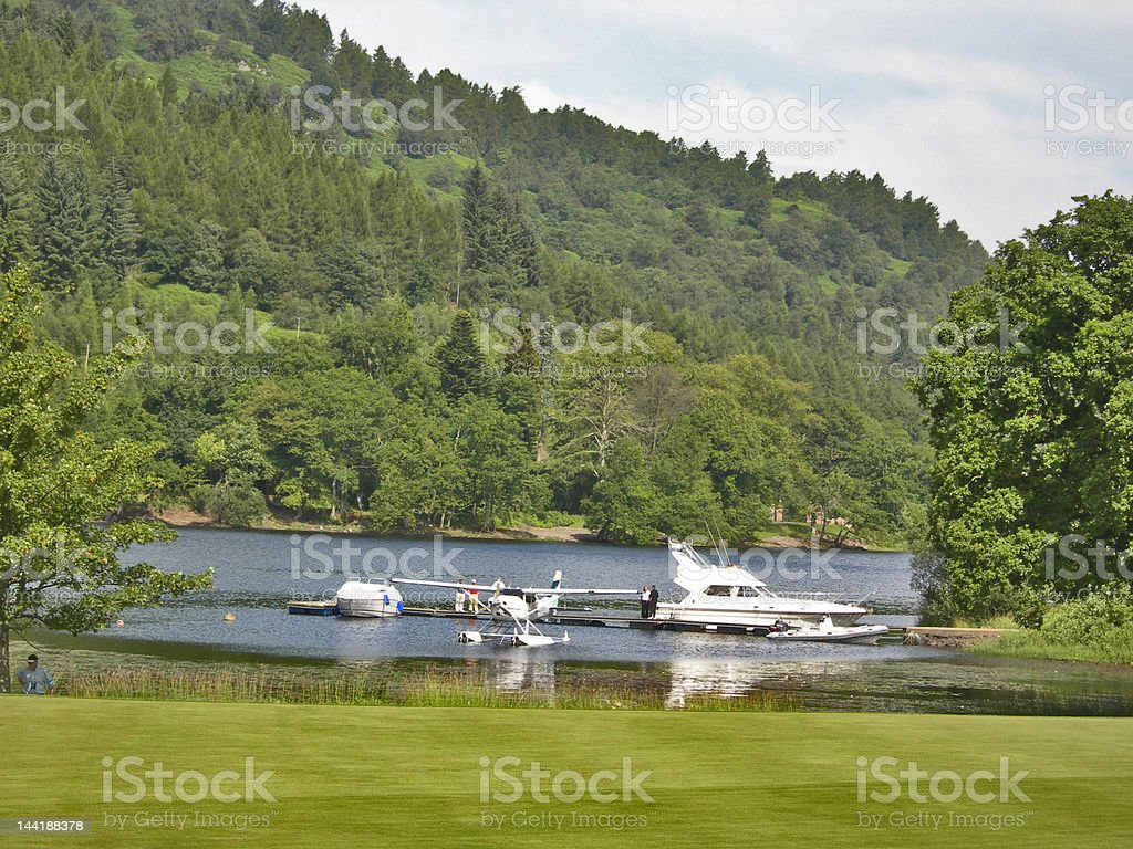 Golf scene 8 with boats on lake royalty-free stock photo