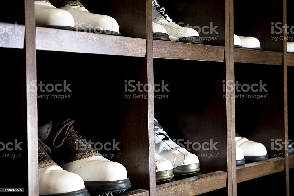 Golf Shoes in men's locker room at club house. stock photo