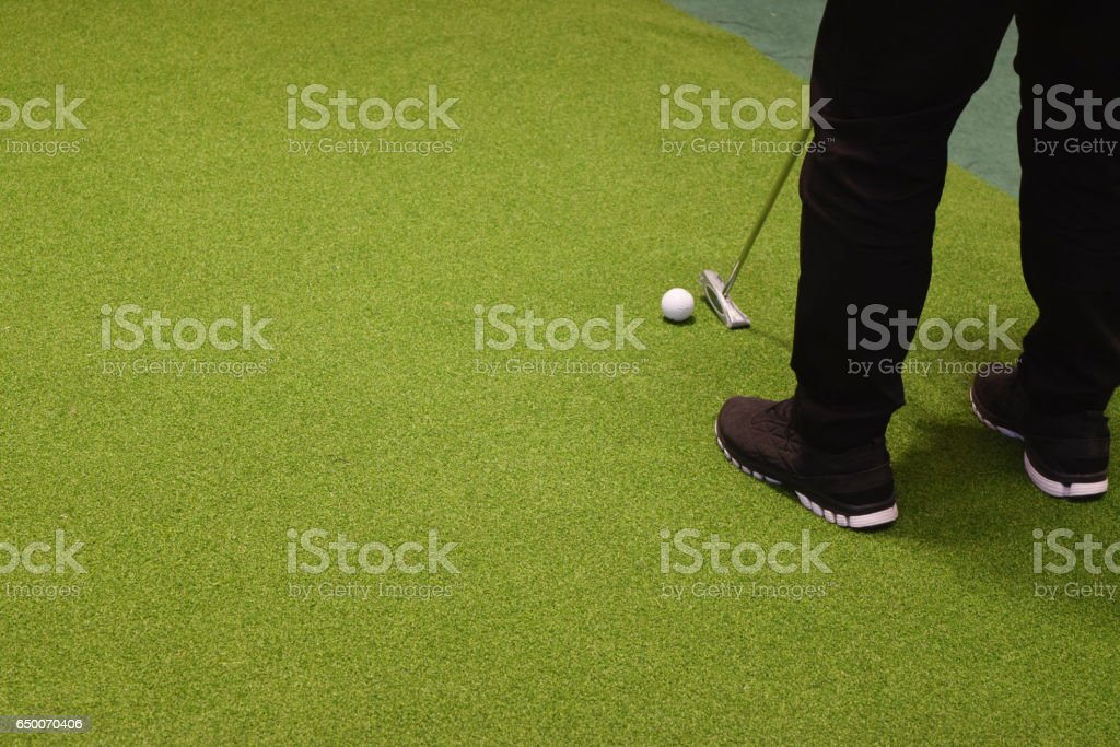 Golf sport club and green grass stock photo