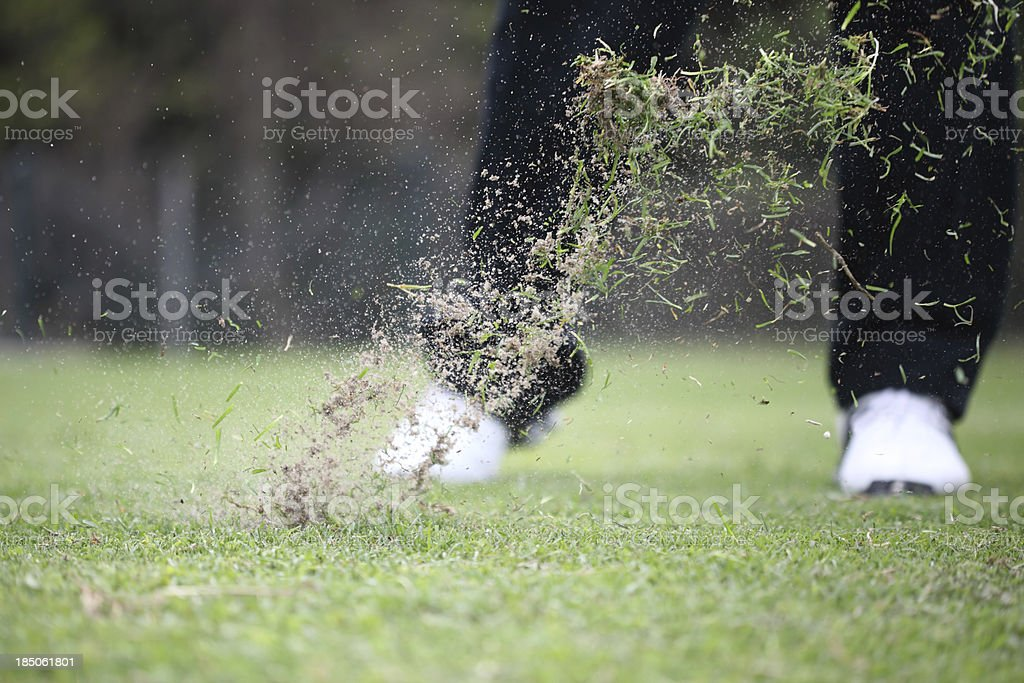 Golf Swing and Grass Flying stock photo