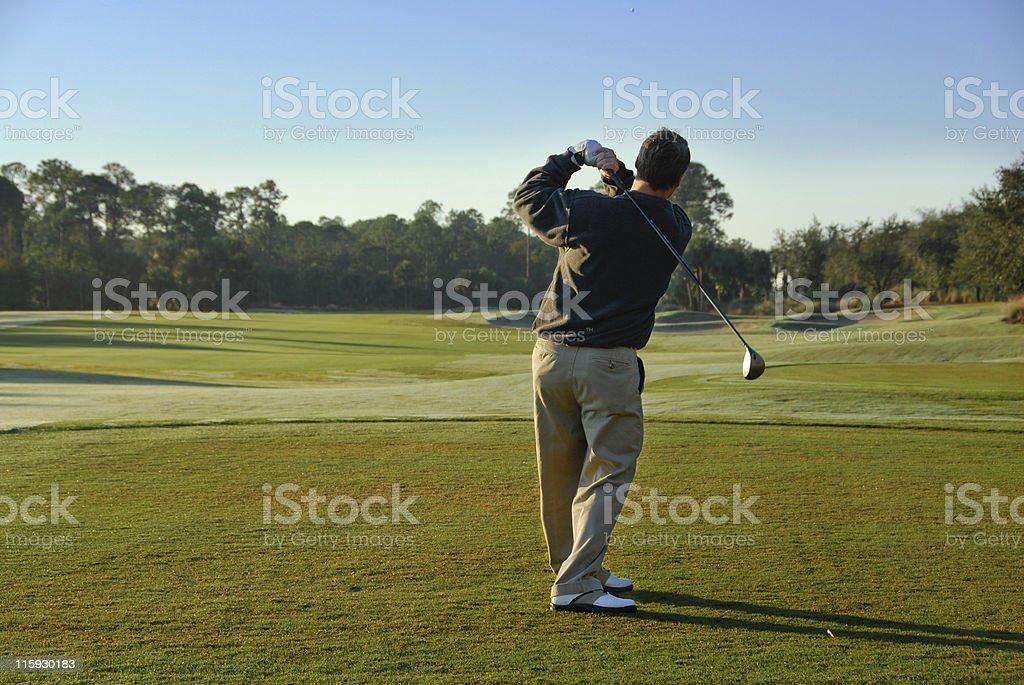 Golf swing ball caught in flight in flight above head