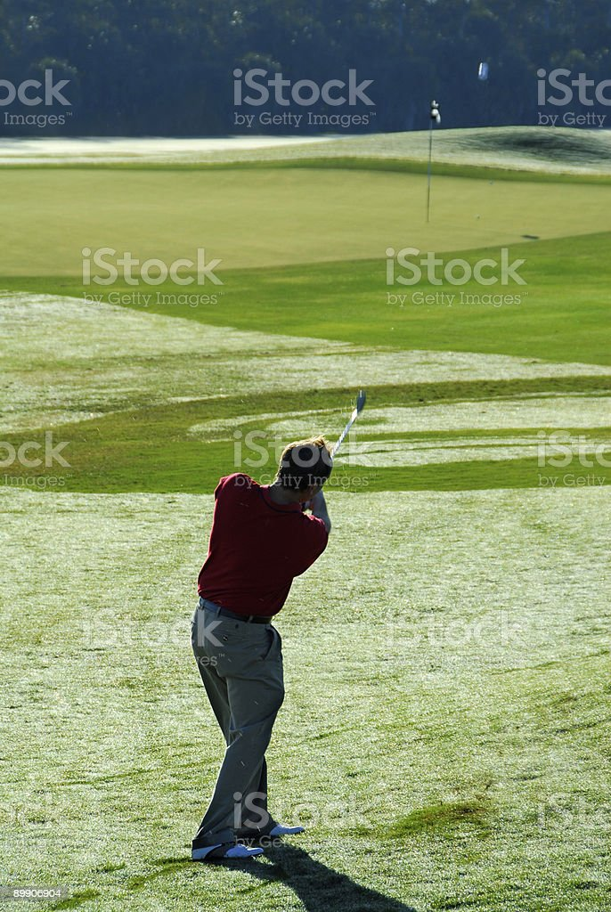 Golf swing - ball in motion royalty-free stock photo