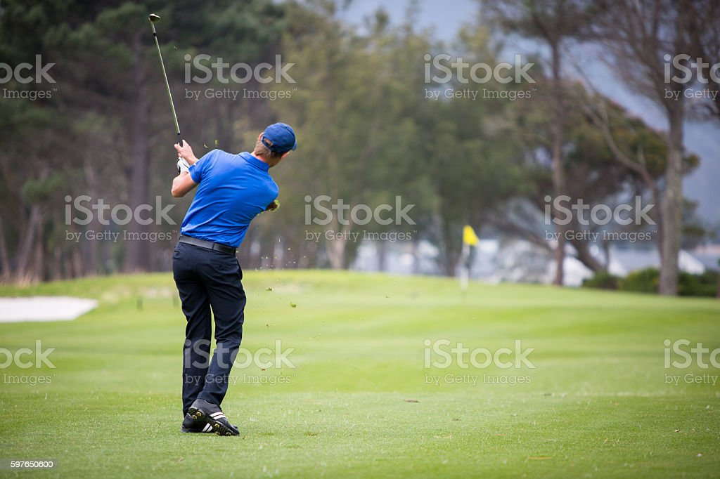 Golf Swing - shot off the fairway for the green stock photo