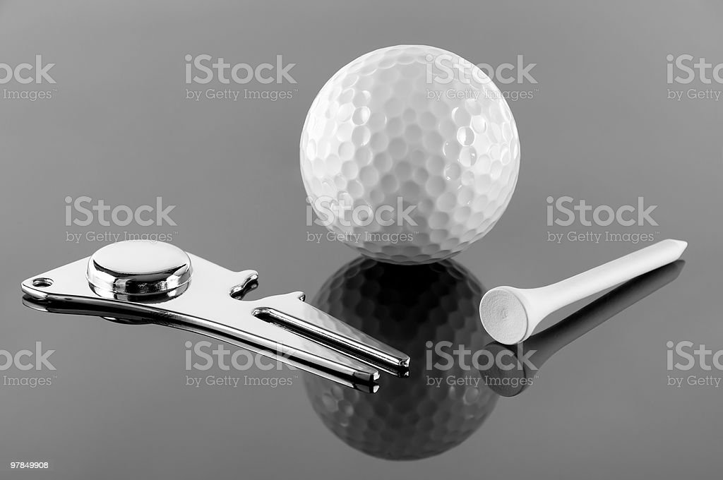 golf T, ball and  divot tool stock photo