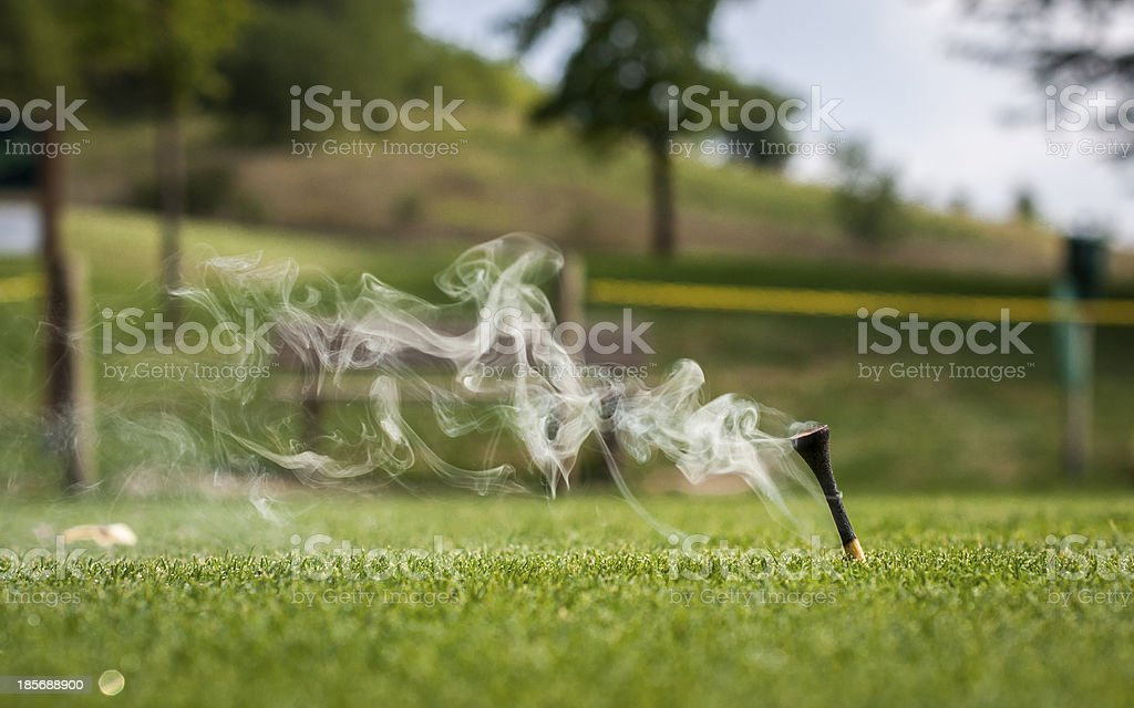 golf tee after the shot royalty-free stock photo