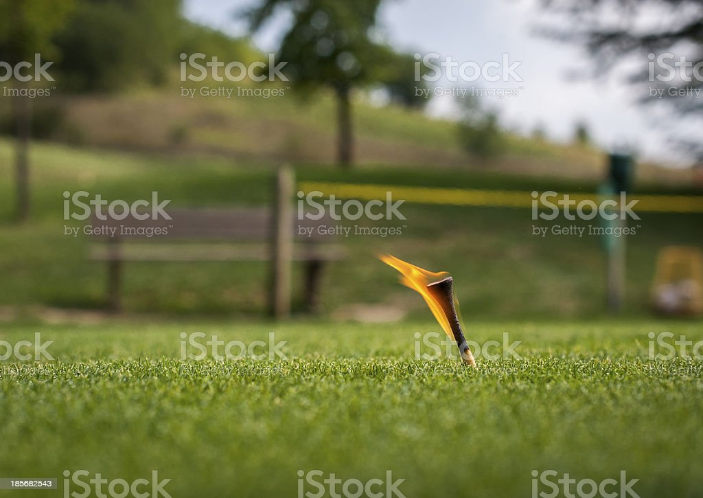 Golf tee on fire royalty-free stock photo