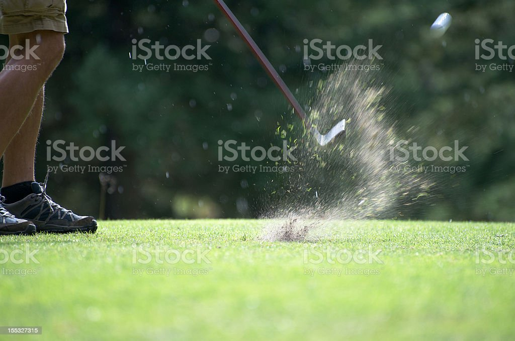 Golf turf explosion with ball in air stock photo