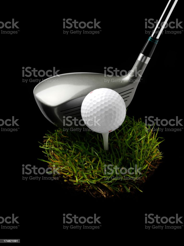 Golf Wood and Ball on a Tuft of Green Grass royalty-free stock photo