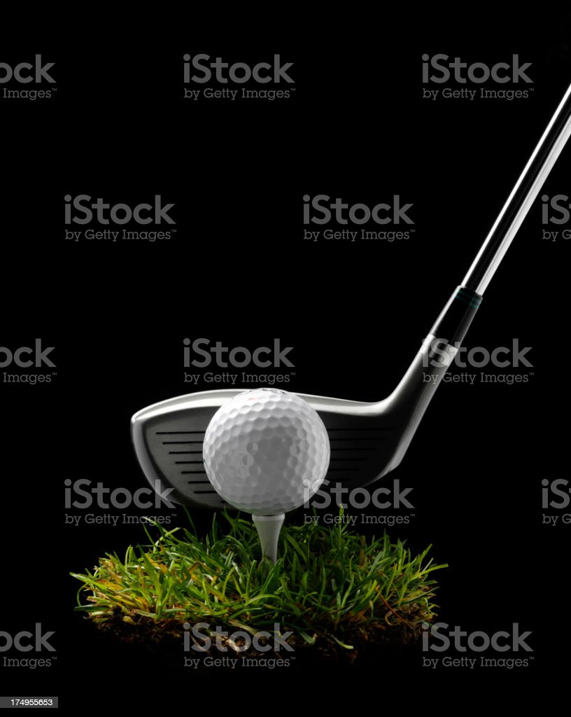 Golf Wood with Ball and Tee on Grass royalty-free stock photo