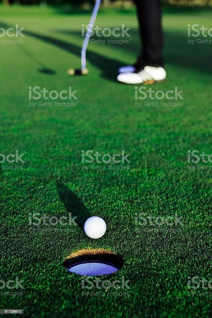 Golfball heading for the hole royalty-free stock photo