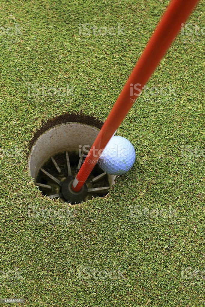 Golfball into the hole royalty-free stock photo
