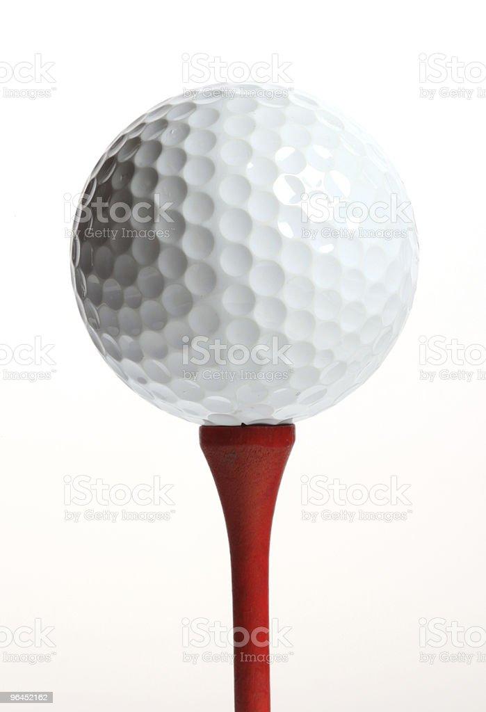Golfball on tee royalty-free stock photo
