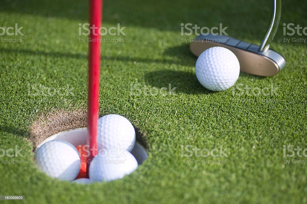golfballs in Hole royalty-free stock photo
