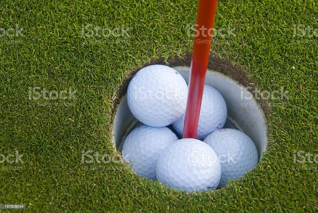golfbballs inside the whole royalty-free stock photo