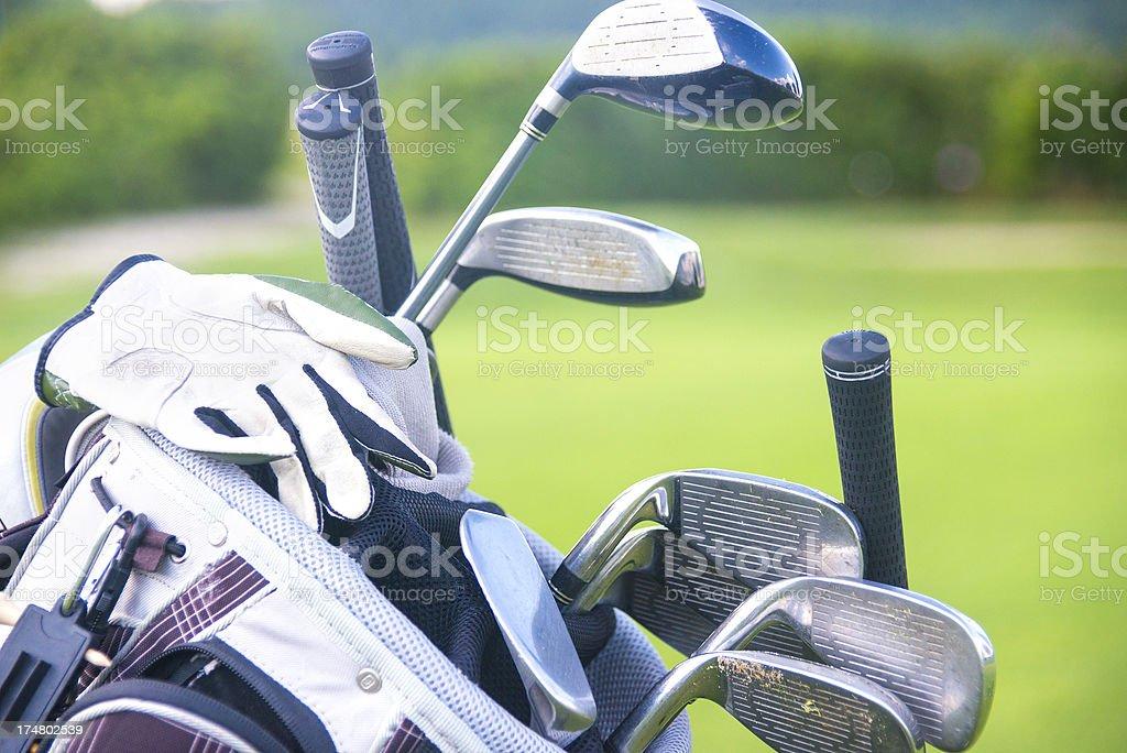 golfclubs golfbag on driving-range fairway royalty-free stock photo