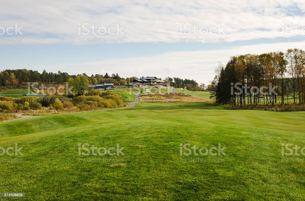 Golfcourse and clubhouse stock photo