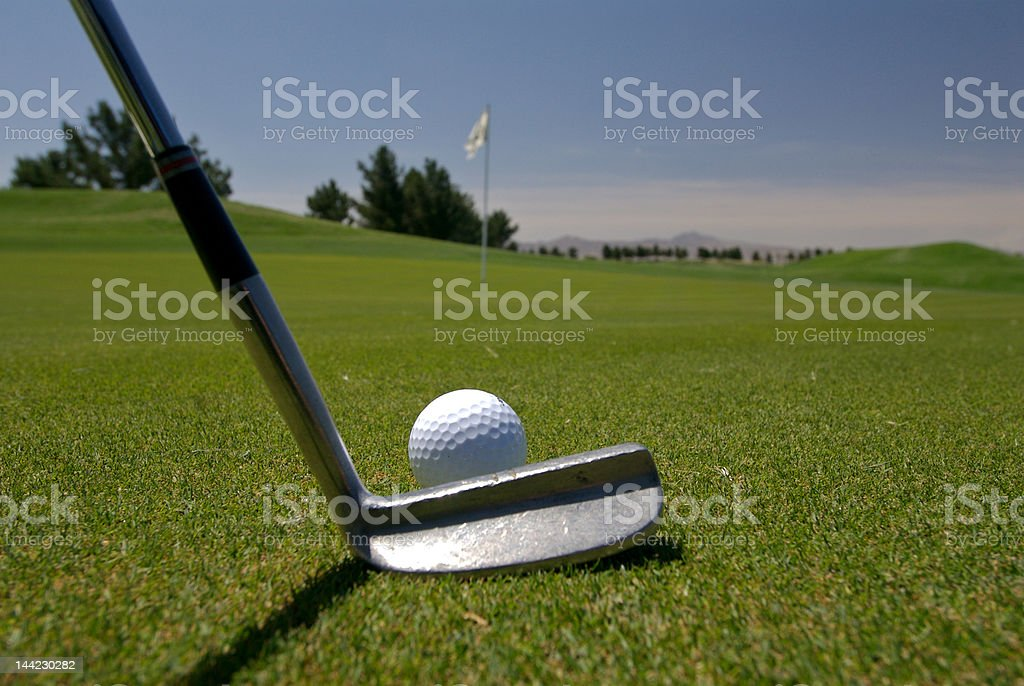 Golfer about to putt stock photo