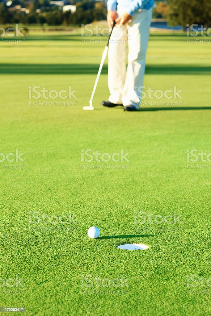 Golfer about to putt the ball royalty-free stock photo