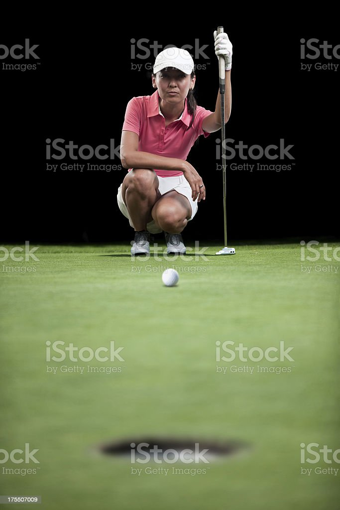 Golfer Aiming Her Putt stock photo