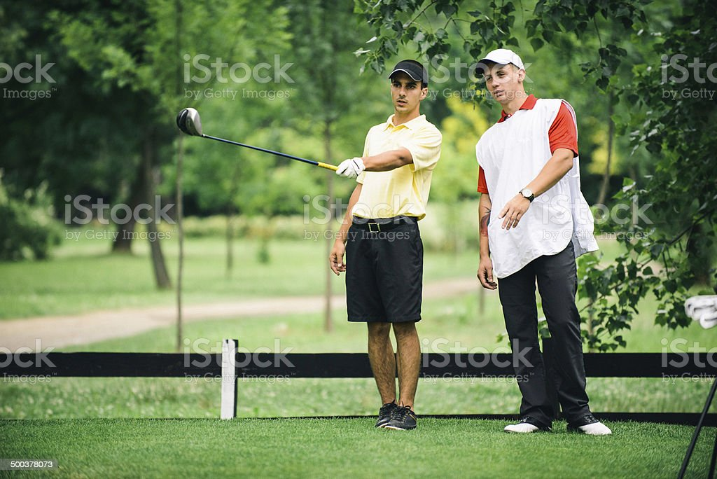 Golfer and Caddy stock photo