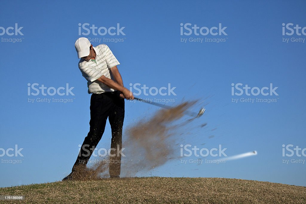 Golfer at Impact Position - Ball in Motion royalty-free stock photo