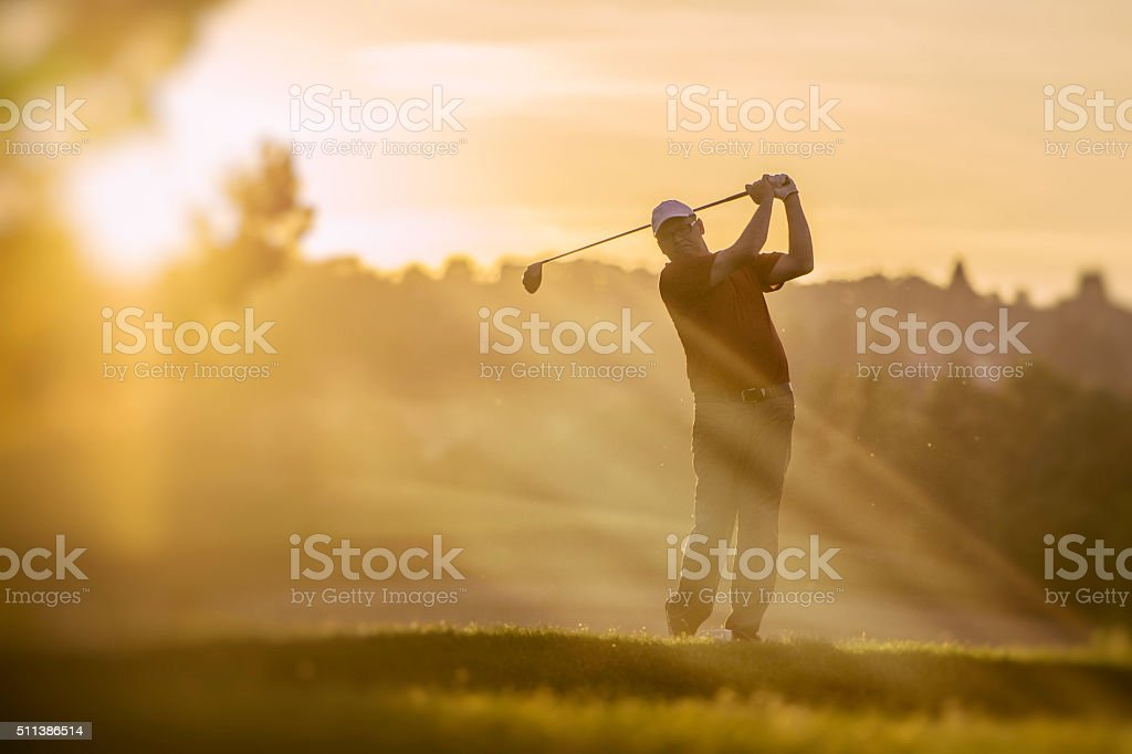 Golfer at Sunset stock photo