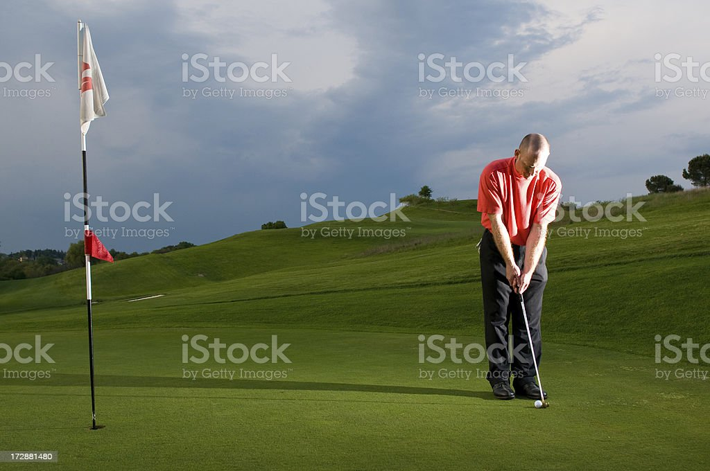 Golfer at twilight 3 royalty-free stock photo
