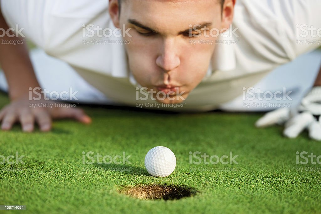 golfer blowing in the ball royalty-free stock photo