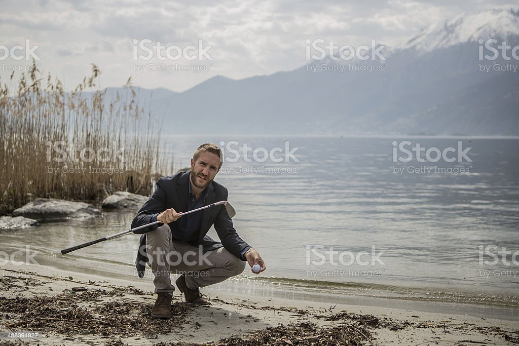 Golfer by the lake royalty-free stock photo