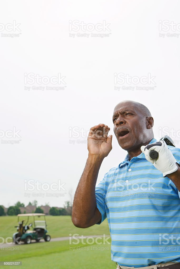 Golfer calling out on golf course stock photo